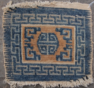 Tiny tibetan mat. All good colours and seems older than most. 19th.c.? 40 x 43cm.