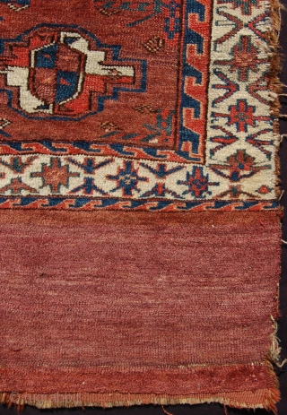 Antique Yomut turkmen chuval. Circa 1860-80. 94 x 79cm. Edge losses and a hole in the skirt. Otherwise decent condition.