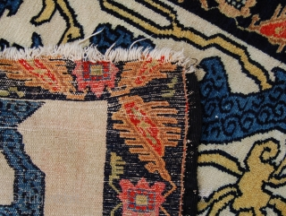 Rare antique Kurdish Senneh mat. Late 19th.c. 96 x 59cm. Losses to the top border. Beautiful white ground garrus design.