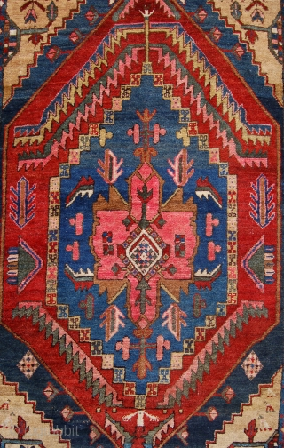 Antique Heriz rug. 198 x 102cm. Nice pile and pretty design. some edge repair.