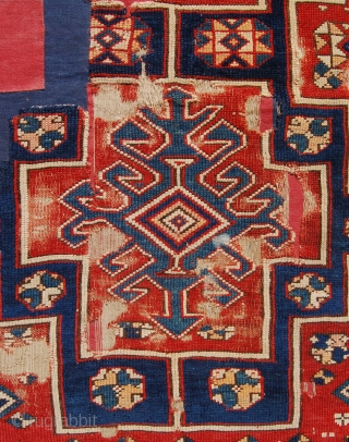 18th century west anatolian rug. Losses patched under coloured fabric.