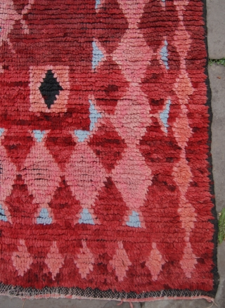 Moroccan carpet. 389x180cm. Possibly Ait Ouaouzguite high Atlas mountains. Early to mid 20th century. Some wear and a small hole to the field. Very graphic.