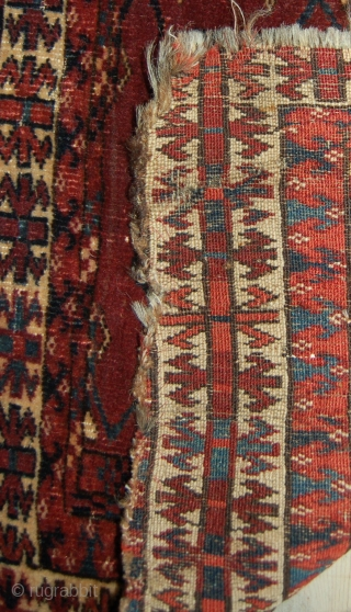 Damaged turkmen chuval. Asymmetric open right with a cotton wool weft structure. Mid 19th.c.112 x 67cm. Please email for further information.