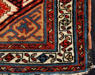 NW Persian camel ground bag face. 19th.c. Good dyes and wool. Needs a little work to the centre but good pile generally.54 x 58cm.