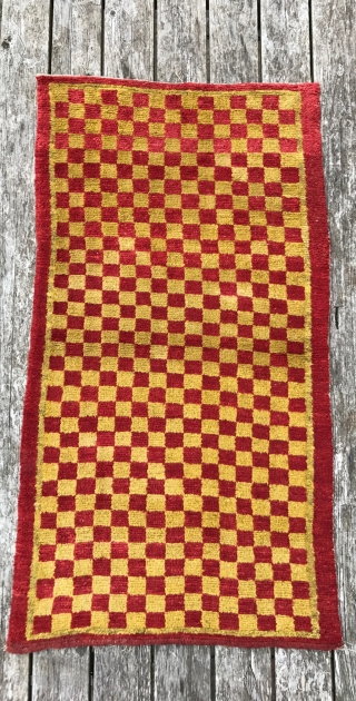 Antique tibetan checker board. Wool foundation and organic dyes. Late 19th century. 146 x 77cm.