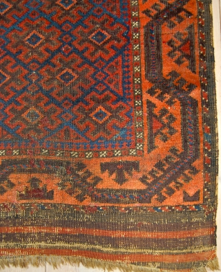 Antique Baluch rug with an archaic field design and shiny wool. 143 x 87cm.Perhaps earlier than most. 19th century.