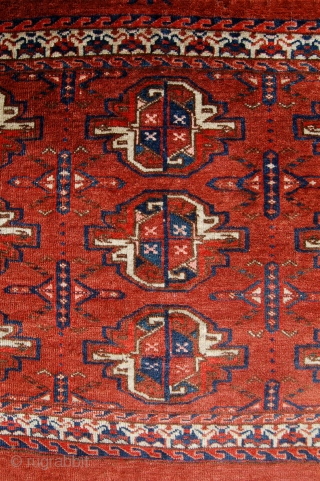 Yomut group chuval.  19th c. Unusual border. Asymmetric open right. Good condition. Original back. 114 x 80cm.