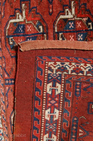 Yomut group chuval.  19th c. Unusual border. Asymmetric open right. Good condition. Original back. 114 x 80cm.