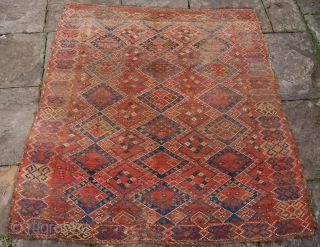 Antique Ersari ikat design rug. 197 x 185 cm. Good age and unusual square size. Fresh to the market and very dirty. Wear and some repair across the centre.
