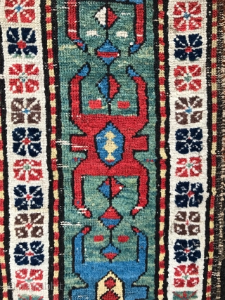 Early south caucasian rug. Freely drawn with a powerful border. Some wear but no hidden repairs or issues. Fresh to the market. 270 x 107cm. Early 19th century.