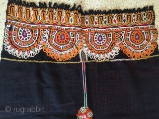 This is kutchi Rabari brides head cloth from bhavanipar Kutch region Gujarat the raw wool shawl is embroided with looped stich work.the raw woollen ground with the and dyed element that mirror  ...