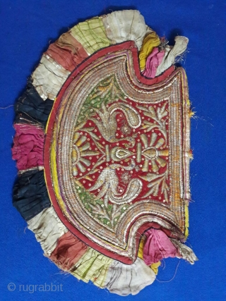 beautiful hand fan of kala batu work with both sides reversible work the size of fan is 11 x 17 inches the fan is in very good condition