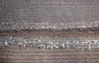 tibetan black brown abrashed saddle top. thick knot, super soft pile with yack hair warps. nice patinated back. complete with original selvedge and ends. no repairs and the expected wear on the  ...