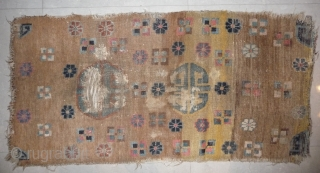 an unusual appealing big tibetan sleeping and/or meditation rug with a totemic like so called shou design and abrashed ground in yellow and brown. what is now called shou design has been  ...