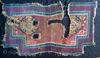 an early tibetan saddle  of an uncommon type. as found,  made in one piece without delimitate center panel.