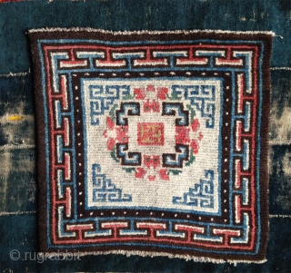 beautiful mid 19th century tibetan square. wonderful natural colors including  strong yellow and greens.a  very happy piece with a not so common white ground..and very good condition