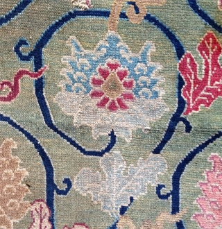 one of the best copy of a ming lotos silk on tibetan rugs. big khaden fragment with a beautiful green ground and a lot of presence. very fine wool foundation and weave.  ...