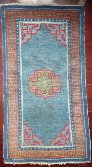 tibetan khaden mid 19th c whith very good colors and good condition, pile is bit low in its exeptional blue field.