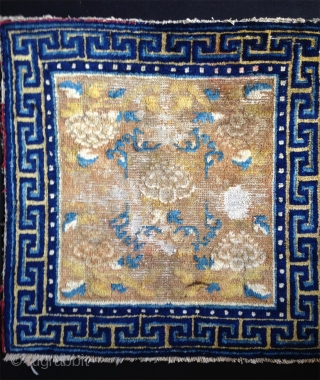 late 18th century ningxia square with 5 peonies. some spots of wear but still very attractiv and with beautiful wool and colors.