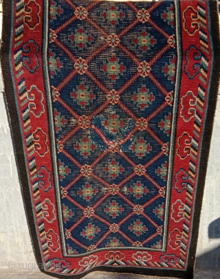 Tibet .  19 century collector piece khaden with fabulous saturated colors, top wool and a rare design.. home made old restoration in the center..can be redone if you cannot live with  ...