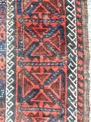 "A small Khorasan MinaKhani Baluch rug of some merit. 32""x 64"" Good condition. Cherry red and light blue highlights. c. 1880."