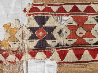 Dramatic and boldly drawn early Anatolian kilim fragment. Professionally mounted on linen. Great color including true camel.
