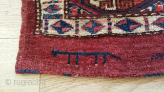 "Yomud Small Bag Face. Small re-piling at corner (see detail). Totemic symbol (see detail). 34"" x 14""."