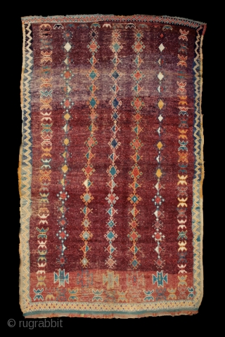 Moroccan 'Taznacht' rug, 138x235 cm, mid. 20th century. Floating rows of small medallions and stars on an aubergine field.... strong colors, strong village/tribal design. Freshly washed, floopy, clean, soft, ready o use.  ...