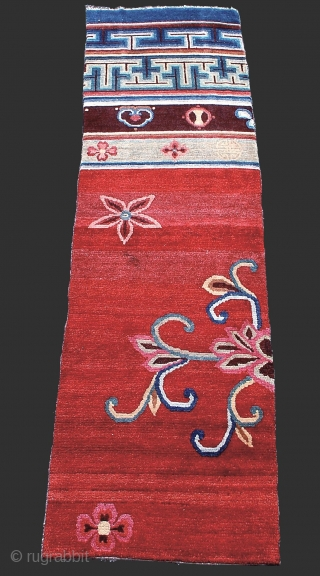 One of a pair of 19th century Tibetan Door Rugs from a Buddhist monestary. This piece and its mate hung together as ornate woven pile door flaps. Thick Tibetan wool and saturated  ...