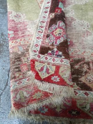 An 1870 Anatolian rug fragment with 160/110 cm.