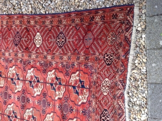 An antique Tekke carpet 315/210 cm. Signs of use.