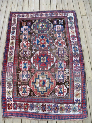 """Armenian Kazak 5'3"""" x 7'10"""" A great old Kazak presumably of Armenian origin with a date of 188(?) Nicely stacked octagons. Areas of wear."""