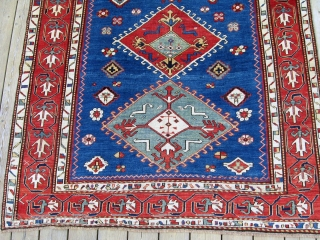 "An elegant blue field Kazak rug with a particularly appealing border design.  Circa 1850, 5'1"" x 8'4"""