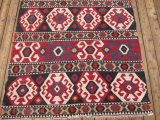 "Zangadzor Region Kilim, S. Caucasus,  5'9"" x 8'11"".  A strikingly beautiful kilim with intense rich colors. There is a sleeve on the back for hanging. Minor restoration along the edges.  ..."