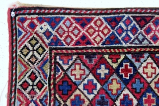 "Shahsavan pile bagface, late 19th c., 21"" x 23"".  Shahsavan pile bag featuring a diamond lattice field enclosing multicolored crosses. An interesting border design and lovely natural colors."