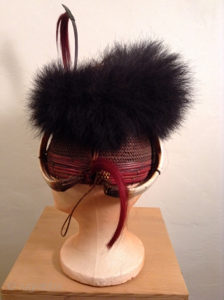 This is a rare headpiece from Nagaland which is a state in Northeast India.  It was used as a ceremonial warrior's hat.  There are four tusks on the headpiece which  ...