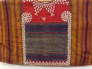 Indonesian vest probably from Sumatra.  Excellent condition, beautifully woven and trimmed with Cowrie Shells.  Can be worn by a small person who would benefit by having very long arms.   ...