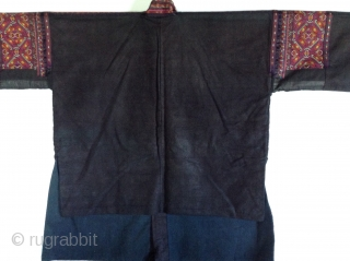 This is a jacket made by the Miao people, one of the largest minority groups in China.  It is an Indigo dyed cotton fabric which is very dark blue-black.  The  ...