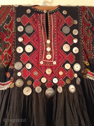 This is a wedding dress from Nuristan which is a province in Afghanistan.  I am guessing that it dates from the early to middle part of the 20th century.  It  ...