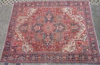 "Heriz 378 x 299 cm., 12'5"" x 9'9"" , with some wear around the center. Heavy and tightly knotted piece, 52 kgs."