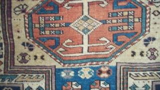 "#7241 Shirvan Antique Caucasian Rug This circa 1875 keyhole design Shirvan antique Oriental Rug measures 3'7"" X 5'3"".   It has a dark blue ground with ivory keyhole center motif.  It  ..."