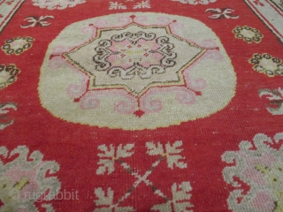 """This circa 1900 Khotan Antique Oriental Rug measures 4'0"""" X 6'5"""". It has a center medallion consisting of an eight pointed star outlined in Khotan pink. The upper and lower corners of  ..."""