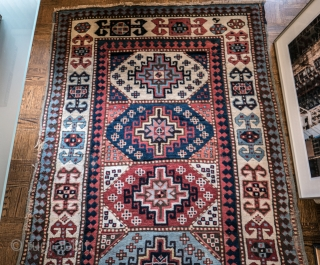 Kazak with memling guls.  Superb wool and colour.  Mostly luscious meaty pile.  As you see, the only colour that repeats in the 'football guls' down the centre is white.  ...