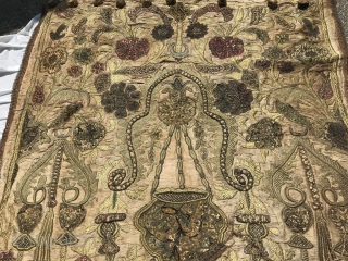 18th C. Turkish Prayer Niche Embroidery  Very dense metallic embroidery forming a prayer niche in center with hanging vessel. Bottom of niche with floral bouquet in vase. Thinner vase pillars go up along  ...