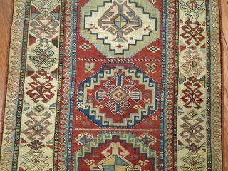 Antique Caucasian Kazak.  Very minimal re piling.  Size is 2'9''x4'11''.