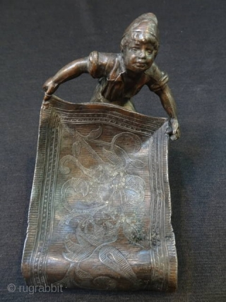 I believe this is bronze but not sure.  Bought it because it reminded me of my childhood.  I don't see any stamp or sign.