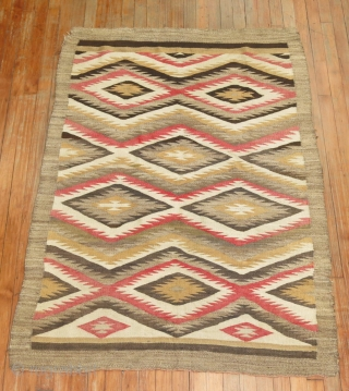 Antique Dazzling Navajo. 3'9''x5'2''.  Excellent condition.  Top left corner need a little attention