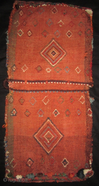Gashgay small saddle bag 34 x 74 cm all over. End 19th cent. There have probably been tassels in every square but now only the knots remain. All natural dyes. More info or photos if you  ...