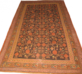 Khotan rug with few low pile areas measuring 295 x 152 cm.