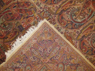 Indian paisley design old rug worn areas measuring 10 x 8 feet approx.